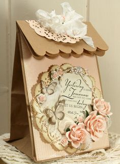 using plain paper bag (brown or colored) w/ bag laying flat trim top edge as desired; fold over & decorate - finishing w/ 2 holes for ribbon. Create card front/  medallion; fill & tie ribbon to close