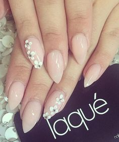 Pretty nude nail art design. A rather simple looking design that gives off a sophisticated aura, adding the tiny white flowers with silver beads on top just adds to its charm. #WeddingNails