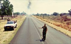 A soldier stands in the middle of the road, smoke behind him Jon Rafman, Michael Wolf, Street Photographers, View Image, New Art, Pop Culture, Country Roads, Street View, This Or That Questions
