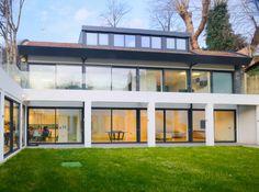 Glass balustrade over white frames