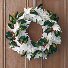 Holiday Felt Wreaths – Winter Leaf: Lush with wintry white leaves, green holly leaves and bright red berries, our wool felt holiday wreath adds seasonal cheer to your home, year after year