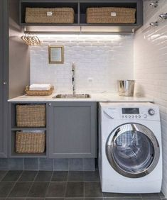 A compact laundry area that recognizes the importance of good lighting…. Grey Laundry Rooms, Laundry Room Cabinets, Farmhouse Laundry Room, Laundry Room Organization, Laundry Room Design, Laundry Area, Compact Laundry, Small Rooms, Small Space