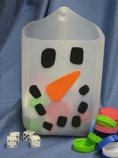 """Snowman Counting Game. Roll the dice and """"feed"""" the snowman. Use cotton balls for snow balls."""