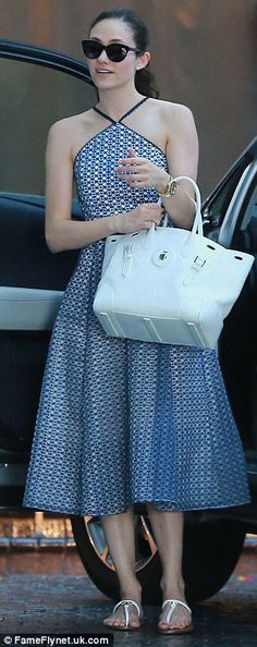 Pretty: The Shameless star's patterned frock cinched in at the waist and featured delicate scalloped straps