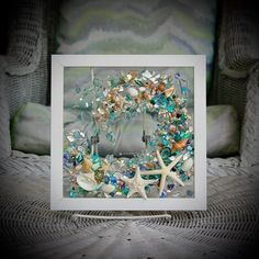 This Sea Glass Wave Art wall hanging is the perfect addition for any beach home or beach bathroom. Sitting in a pure white frame, this seashell wave measures approximately 9 x 9.  All the shells are attached with resin, to the clear glass, which bonds and adds the illusion of water droplets. There Blue Wall Decor, Beach Bathrooms, Wave Art, Beach Cottage Decor, Beach Wall Art, Glass Art, Sea Glass, Bathroom Wall Art, Hanging Wall Art