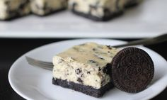 Oreo cheesecake slice is a little piece of heaven. It has a crushed Oreo base with a baked cheesecake top that has chopped Oreo biscuits all the way through.