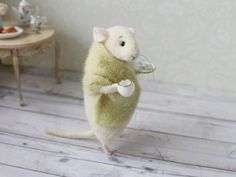 This lovely little mouse is handmade from high-quality merino wool (produced in New Zealand) using needle felt techniques. You get it holding a porcelain cup and the saucer (a real porcelain, not plastic). Inside there is a wire frame, which makes paws and tail flexible. All of my