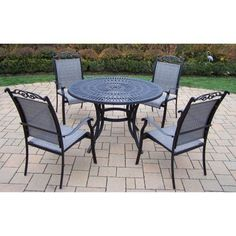 """Sunray 5 Piece Dining Set Finish: Black by Oakland Living. $1319.00. 2137-10605-C-5-BK Finish: Black Features: -Table top has an opening for an umbrella.-Hardened powder coat for years of beauty.-Fade, chip and crack resistant. Includes: -Includes one dining table and four sling chairs. Construction: -Rust free aluminum and sling construction. Assembly Instructions: -Stainless Steel, galvanized or brass assembly hardware. Dimensions: -Overall dimensions: 29"""" H x 4..."""