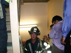 John Labriola, who had an office on the 71st Floor of the Tower One snapped this photo of firefighter Mike Kehoe rushing up the Tower One as Labriola was evacuating. The photo was taken just minutes before the tower collapsed, and when the Daily Mirror ran the next morning, the editors were uncertain whether he survived or not. Six of his colleagues who went up the same staircase died, but Kehoe survived.