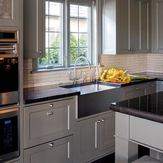 Simple lines, gray cabinets. love the tile. Southern Accent ASID Winner 2008