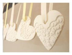 These French Lace Ornaments ($30) Hang them from a vase of oversized flowering branches for major romance.