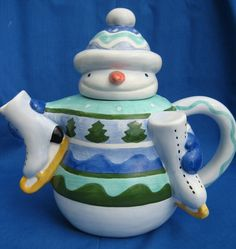 Snowman with Skates teapot . dressed in blue and green sweater and toque with Christmas trees on it, holding pair of figure skates, ceramic Christmas Tea Party, Christmas China, Christmas Dishes, Christmas Holidays, Christmas Snowman, Christmas Trees, Tea Cup Saucer, Tea Cups, Happy Tea