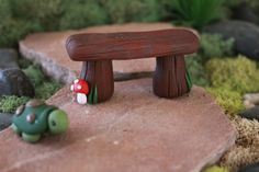 This listing is for ONE (1) hand sculpted polymer clay wood bench. The bridge stands approximately 1.25 tall and is 2.5 long. Hand sculpted without
