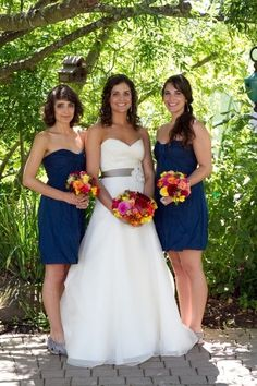 love this gorgeous A-line dress.. and i'm liking the navy blue bridesmaid ones as well...wish they all had straps