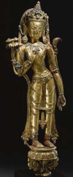 14-or-16th-c-tibet-vajrapani-gilt-cop-turq-inlay-40-cm-vajraflywhisk-on-lotuses-sothebys.jpg (247×594)