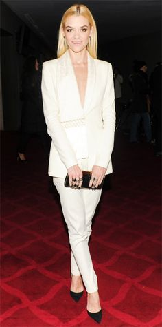 Jaime King suited up for the Cole Haan and New York City Ballet celebration in white Altuzarra suit separates (with fringe detailing), complete with a metallic clutch, stacked rings on every digit, and black pumps