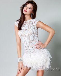 Embroidered lace feathered skirt short dress. Find this look in black and other dresses by Jovani at Béatitude in Boerne, TX! http://www.facebook.com/pages/Béatitude/234128800013119
