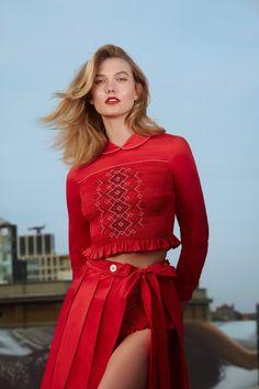 Karlie Kloss wears Miu Miu top, skirt and briefs