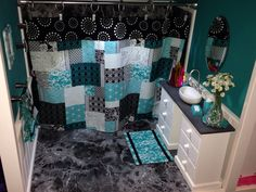 Just a view with the curtain closed. Shower curtain  rug are reversible. The vanity is two jewelry boxes from joannes painted white. Piece of wood cut for vanity  fleck stone applied. The sink is actually a magnetic paper clip holder I ordered from Amazon.