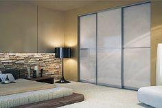 Custom aluminum-framed sliding closet doors with glass by SpaceSolutions.ca