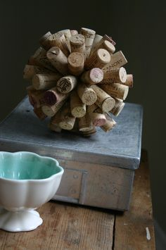Most people who collect their wine corks display it in a large vase. Here's a crafty, decorative twist that only uses corks and a styrofoam ball. Would look nice displayed at your home bar