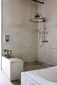Refreshingly sparse shower space with nothing but concrete. The height and openness of the layout make this bathroom really unique
