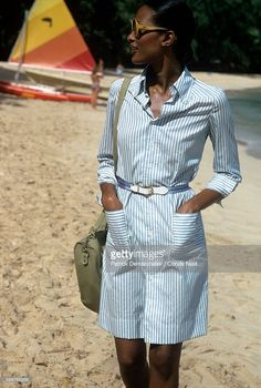 News Photo : Model Beverly Johnson in large sunglasses walking...