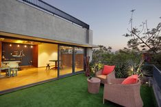 An Exposed Brick Front Elevation Gives the Villa an Evergreen Look Brick Masonry, Front Elevation, Outdoor Furniture Sets, Outdoor Decor, Exposed Brick, Architect Design, Luxury Villa, Terrazzo, Brick Wall