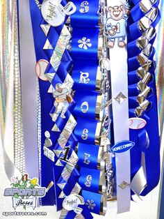 The Sports Roses Homecoming Mum was decorated with lots of sport-themed trinkets.  Use sticker glitter letters to add names to the ribbon.  Also add a memorable touch with Sports Roses available online at http://sportro.se/mums-garters