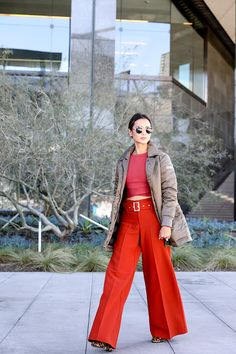 Photographed by Jana Williams Big red pants and top by Lucy Paris, Jimmy Choo Bag, Perverse Sunnies, Tatras Coat. JavaScript is currently disabled in this browser. Reactivate it to view this content.