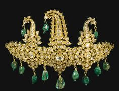A gold and enamelled diamond-set sarpech, Benares, circa 1850, formed of eight hinged sections set with diamonds to the front with twelve drilled pendant emeralds suspended from the top and bottom, the reverse decorated with finely enamelled pink lotus flowers (front)
