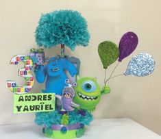 Check out this item in my Etsy shop https://www.etsy.com/listing/206659833/monsters-inc-centerpiece-birthday