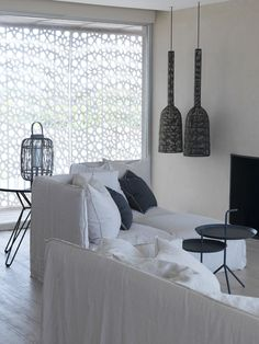 The Moroccan-inspired panels Creates playful patterns on the surfaces inside the house.