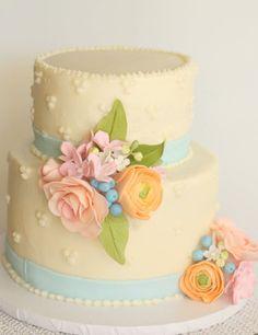 Spring flowers cake for an 80th birthday. gumpaste flowers on buttercream cake.