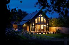 A picturesque, oak frame barn-style self-build home in Cambridgeshire. The new home features a timber clad exterior and a large area of south-facing glazing Oak Framed Buildings, Metal Buildings, Oak Frame House, Self Build Houses, Modern Barn House, Pole Barn Homes, Prefab Homes, Log Homes, Building A House