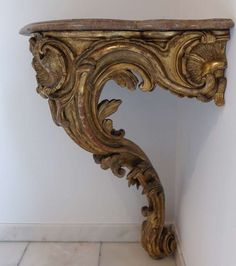 French Louis XV Mid- 18th c. Giltwood Corner Console   From a unique collection of antique and modern console tables at http://www.1stdibs.com/furniture/tables/console-tables/