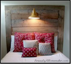 old wood plus plug in lamp (chord behind wood) = awesome, easy, cheap headboard