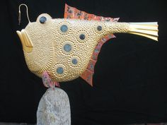 """""""Walter""""  I've made a number of Walters and this one features hand blown glass bumps, copper fins and glass eyes...  He's 23k gold leafed and sits on a stone from the Maine coast.  www.tjmcdermott.com"""