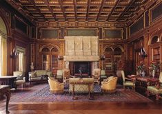 The library at The Breakers, the Vanderbilt family's summer house in Newport, Rhode Island. The square-foot mansion was built between 1893 and The library has coffered ceilings painted with a dolphin, symbolic of the sea and hospitality. Stone Chimney, Beautiful Library, Newport Rhode Island, The Breakers, Home Libraries, Second Empire, Grand Homes, French Chateau, Historic Homes