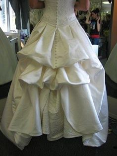 I love bustles! This explains about the different kinds used on wedding dresses and how they work.