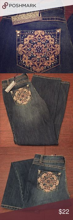"""🆕 Bandolino Bootcut Blue Jeans 10 🆕 Bandolino Blue Bootcut Jeans.👖Size 10, w/ stretch! Good for curvy legs! Ornate silver/gray back pockets w/ rhinestone decoration. 👖Style: Tatum, Hillcrest Wash. 👖Measurements: Waist: ~16.5"""" flat / 33"""" full. Total length: ~41"""", Inseam: ~31"""". Hips: ~21"""" flat / 42"""" full. Thigh width: ~11.75"""" inches flat @ crotch seam. Leg opening: ~9.75"""" flat. Front rise: ~10.25"""", back rise: ~13"""".👖Front & back pockets!👖New W/ Tags! Retail: $59. Offers welcome…"""