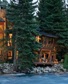 """River House, Aspen, Colorado :: """"Situated on a steep, wooded bank (the lot slants up to 30 degrees) a mere 10 feet from the Roaring Fork River on Lower River Road in Old Snowmass, the three-level design is virtually suspended above the water among the branches, like a modern interpretation of a treehouse. ... you can see and hear the river from every room."""""""