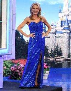 FAVIANA: Royal blue fully sequined gown, strapless, bodice w/soft pleats into left front midriff, skirt w/flared hemline and train, front left slit  | Vanna White's dresses | Wheel of Fortune