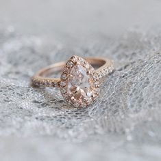 A gorgeous pear shaped diamond in the Rose Gold Fancy Halo Diamond Ring -- this looks a lot like my ring! Pear Shaped Diamond, Halo Diamond, Pear Diamond, Or Rose, Rose Gold, Diamond Are A Girls Best Friend, Jewelery, Jewellery Rings, Women Jewelry