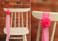 Ribbon chair decor with single paper flower.  [Source gold ribbon (glitter) with gold flower.]
