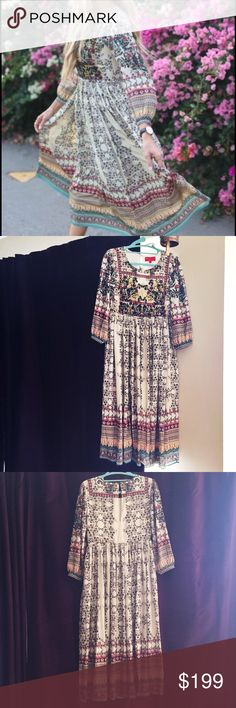 "NEW anthro long-sleeved boho dress! This dress is gorgeous!! And at 5'3"", it's so hard to find a long dress that isn't dragging on the floor! The top has little beaded flowers, which were hard to show in the photos. The price of this dress was $248, and it didn't fit me quite right. Never worn. So sad. The designer is Bhanuni by Jyoti. Size 2P. I have the little bag with extra buttons and beads. Let me know if you have any questions :) Anthropologie Dresses Maxi"