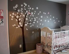 "Contemporary cherry blossom tree with blowing flowers and flying birds and butterflies. PRODUCT DETAILS: All the decals are separate pieces so you can arrange the flowers and animals just the way you want. Approx. Size of Wall Decal Shown: 80"" Tall x 88"" Wide Colors Used: Brown tree, white flowers (can be made in two colors) and soft pink for birds/butterflies. Please contact us if you want to get a free custom preview done so you can see how your custom name will look like ..."