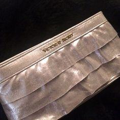 Victoria secret gold clutch purse make up bag Victoria's Secret pink gold ruffled make up bag clutch purse. Perfect new condition never used Victoria's Secret Bags Clutches & Wristlets