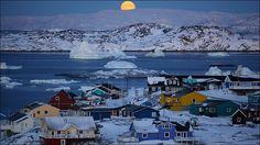 El primer sol naciente después de tres meses de total oscuridad, produce expectación en esta parte de Groenlandia. La vida de los próximos meses transcurrirá bajo un cielo teñido de púrpura, y un sol tímido y suave. Foto: Timothy Allen/BBC Mundo