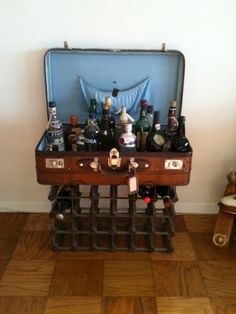 @Desiree Ducharme This is the concept i am basing my idea, what do you think? Bar and wine rack made from suitcase by CruckandGreenway on Etsy, $659.00